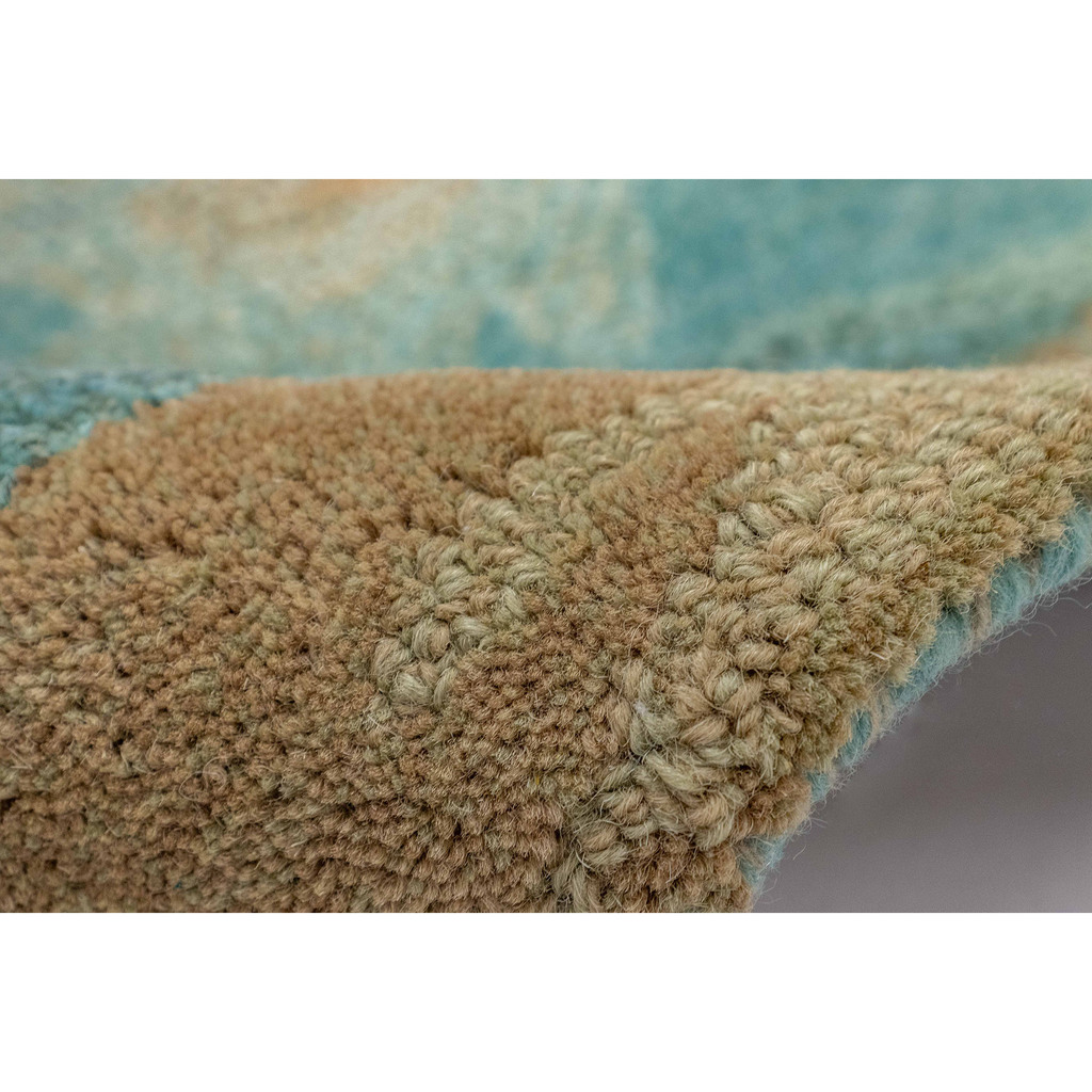 Teal Waterfall Hand-Tufted Wool Rug pile and roll