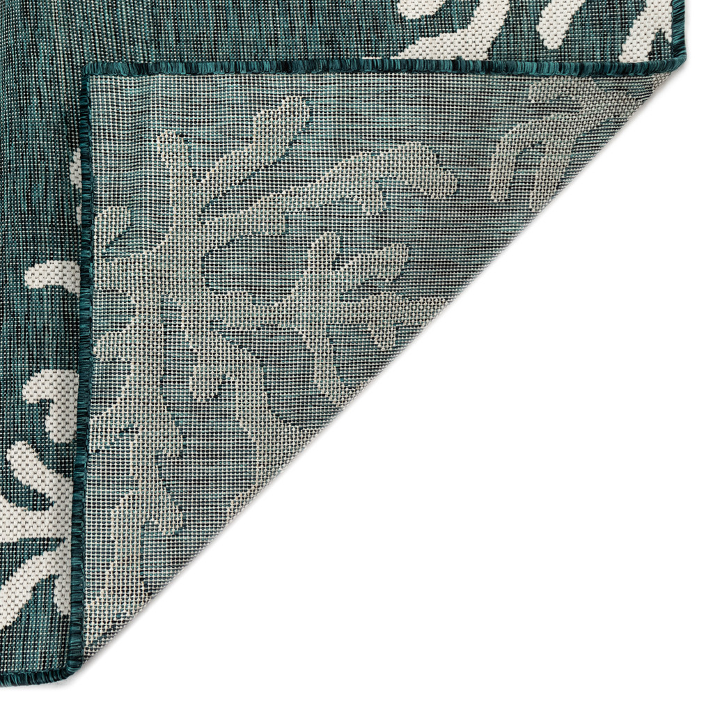 Coral Branch Teal Carmel Rug back