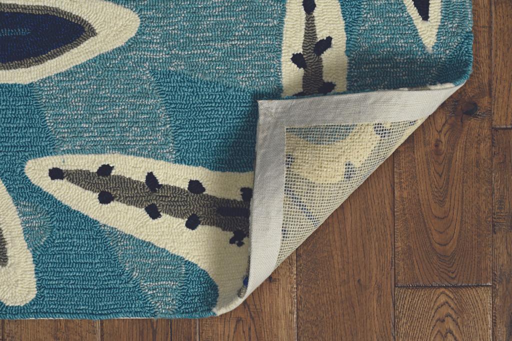 Harbor Blue Sands and Seastar Indoor-Outdoor Rug corner and backing