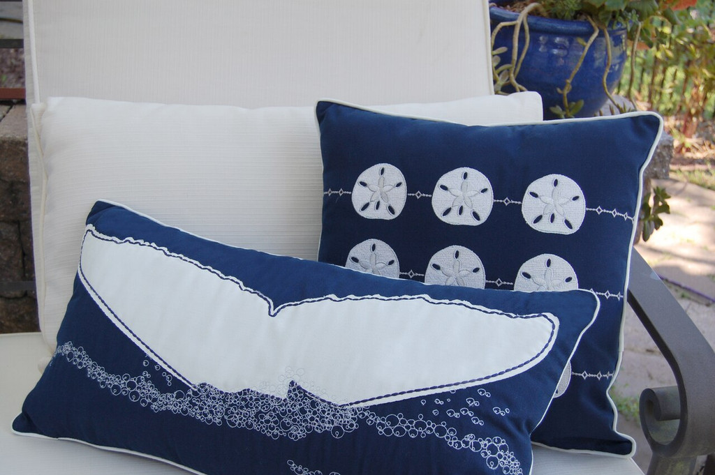 Whale's Tail Embroidered Rectangle Pillow room view with sand dollar pillow