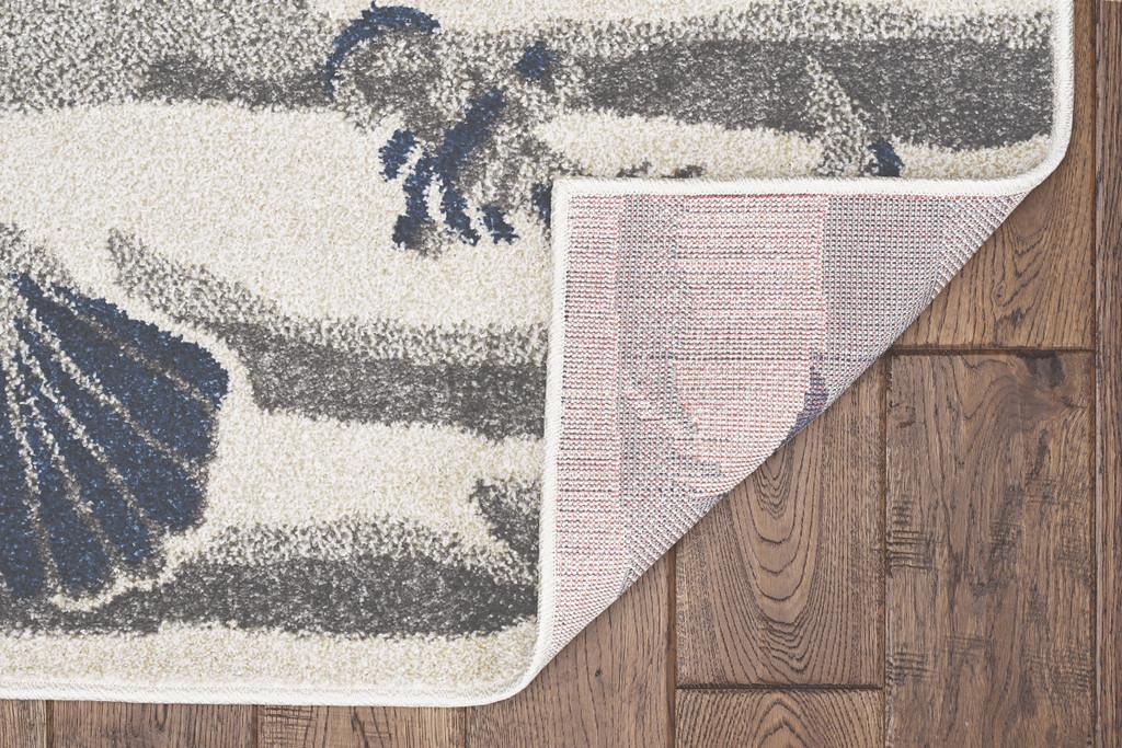 Ivory Seashore Waves Indoor-Outdoor Rug backing