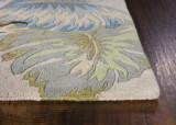 Ivory and Blue Island Oasis Luxury Rug  corner image