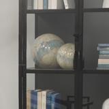 Glass Float Balls in Pale Blue Glass on bookshelf