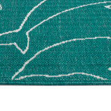 Teal Diving Dolphins Indoor-Outdoor Rug edge