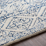 Ionian Cream and Blue Hand-Tufted Wool Area Rug edge