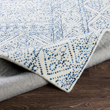 Ionian Cream and Blue Hand-Tufted Wool Area Rug fold