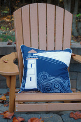 Light The Night Embroidered Indoor-Outdoor Pillow on deck chair