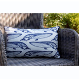 Vintage Whale Embroidered Indoor-Outdoor Pillow on deck chair