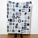 Nautical Signal Flags Knit Throw in Shades of Blue