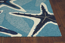 Harbor Blue Sands and Seastar Indoor-Outdoor Rug corner and pile