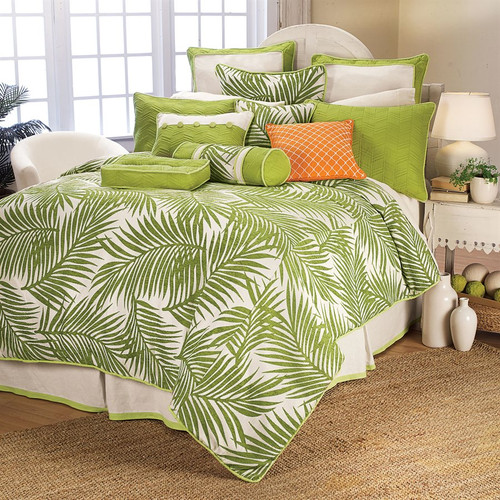Capri Palm Neckroll Pillow shown with bedding collection