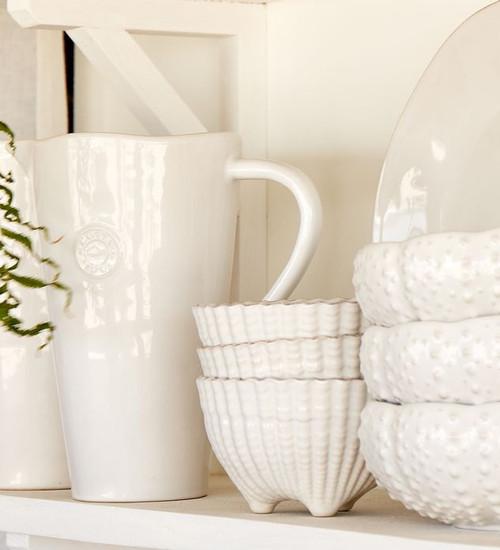 White Aparte Shell Footed Bowls - Set of Six on shelf