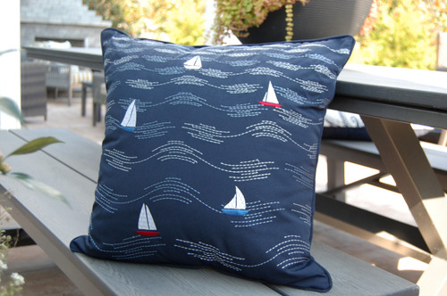 Waves and Sailboats Embroidered Indoor-Outdoor Pillow on deck