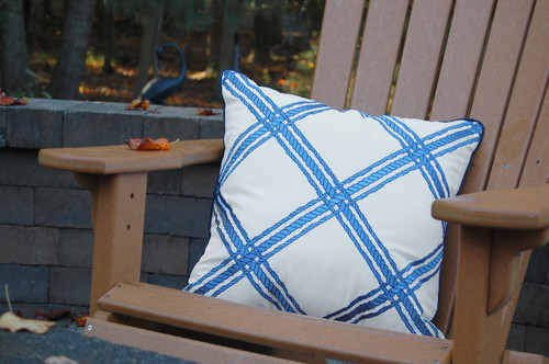 Nautical Blue Rope Lattice Embroidered Pillow on chair