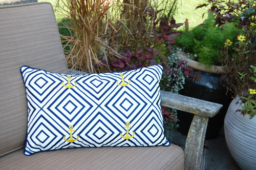 Geometric Blue and Gold Anchor Embroidered Pillow on deck