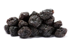 Organic pitted prunes in pile