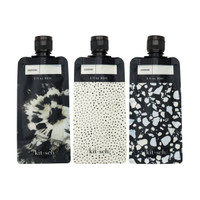 BLK/IVORY REFILLABLE TRAVEL POUCHES