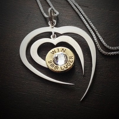 Piercing Heart Bullet Necklace