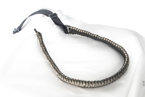 """The GUNSLING by Sure-Shot Game Calls  Featured in NRA American Rifleman Magazine. Made fromMil Spec paracord 2 point sling with quick connect swivels. Adjustable from 33"""" to 44"""" and is lightweight and comfortable. Has hundreds of survival uses, making this sling functional in many ways if needed in an emergency. Perfect for use as a rifle sling, shotgun sling, and even a crossbow sling! And looks great on all firearms, both traditional and tactical. Comes in Camo with Olive Drab. And has a signature branded Sure-Shot Game Calls band that doubles as a handle to keep your gun steady when navigating rough terrain, timber,and marsh! The GUNSLING by Sure-Shot Game Calls matches and teams up perfectly with The LANYARD by Sure-Shot Game Calls. Brought to you by the Inventors of the Double Reed Duck Call, Triple Reed Duck Call, and the YENTZEN Classic..."""