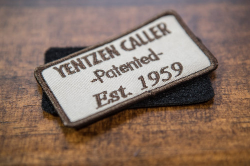 "YENTZEN CALLER PATCH (VELCRO or IRON ON)     From the inventors of the double reed, triple reed duck call, and the YENTZEN CALLER....   Our new popular YENTZEN CALLER Logo Patch that you can put on all your favorite hunting gear and show off your YENTZEN pride!!!  The first double reed patented in 1950 by George Yentzen and perfected by World Champion and Hall of Fame Member, James ""Cowboy"" Fernandez, YENTZEN CALLER stands as a Waterfowl Icon and timeless perfection with its sound and durability that's lasted over 60 years!    Let 'em know your call is the only call and has the waterfowl heritage and history to back it up, with the YENTZEN patch!"