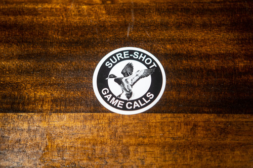 From the inventors of the Double Reed Duck Call, Triple Reed Duck Call,and the YENTZEN Classic..... Our logo styled in a durable and waterproofoutdoor sticker. Weather and Waterproof UV Coated for durability Black and White colors Represent the Sure-Shot brand