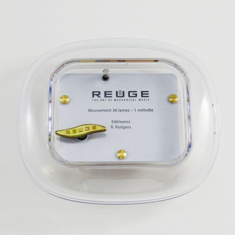 Translucent 36 Note Reuge Swiss Musical Oval Paperweight
