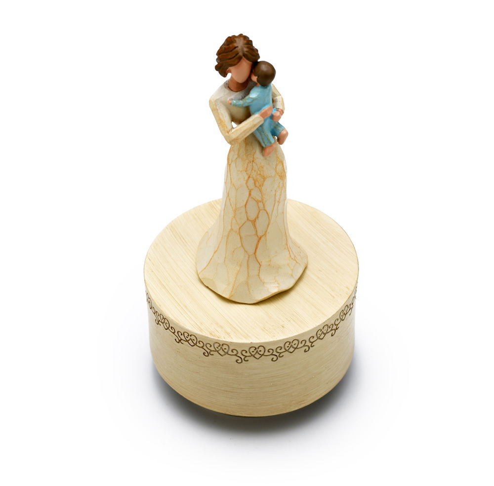 Carved Wooden Design - Sculpted Mother Holding Baby