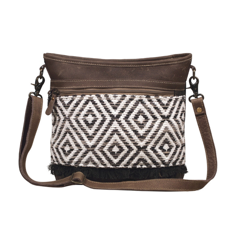 A shoulder bag with a fresh geometrical pattern, suave leather patches and an arched design. Created with roomy inner pockets and reinforced with a durable military tent material backing.