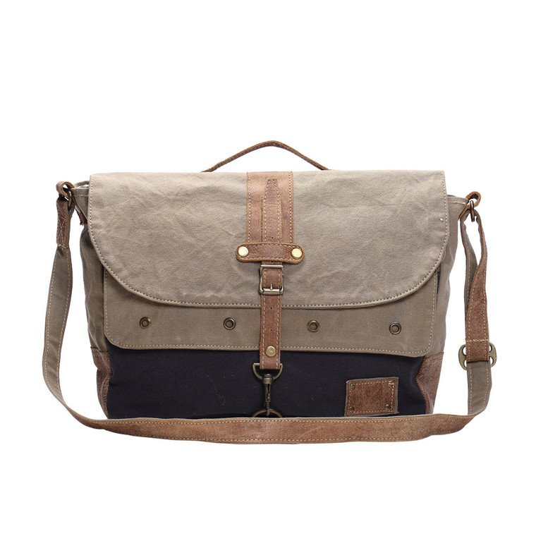 This messenger bag is praised for both men and women for its classic look. Truly a multifunctional upcycled canvas and leather messenger bag having a flapover covered and adjustable shoulder strap.