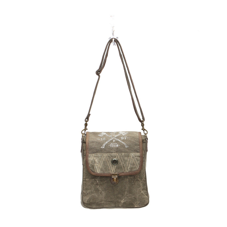 Simple design, well sewn craftsmanship.This stylish crossbody bag offers storage for your tablet and other essentials for a day of traveling or a trek through the urban jungle. Roomy fully lined fabric compartment. Made of upcycled canvas and leather.