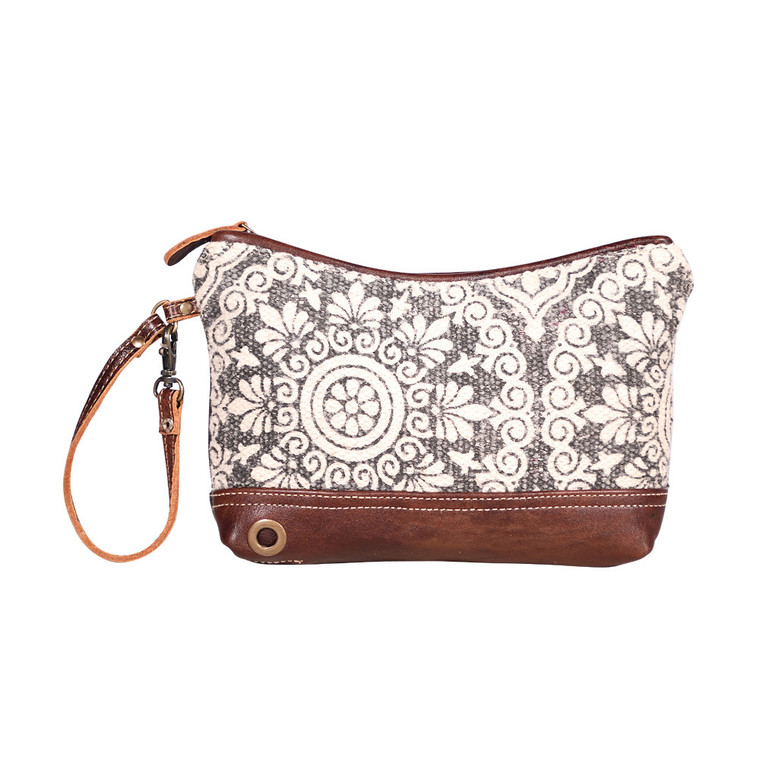 This is a wristlet pouch with an attitude. The white and florally front gives you classy looks while its black back provides a bold touch. Made of upcycled canvas and leather.