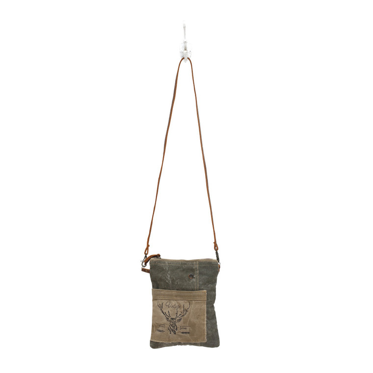 With vintage leafed stenciled on one side this bag is bounded as classic chic. Made of upcycled canvas and leather.