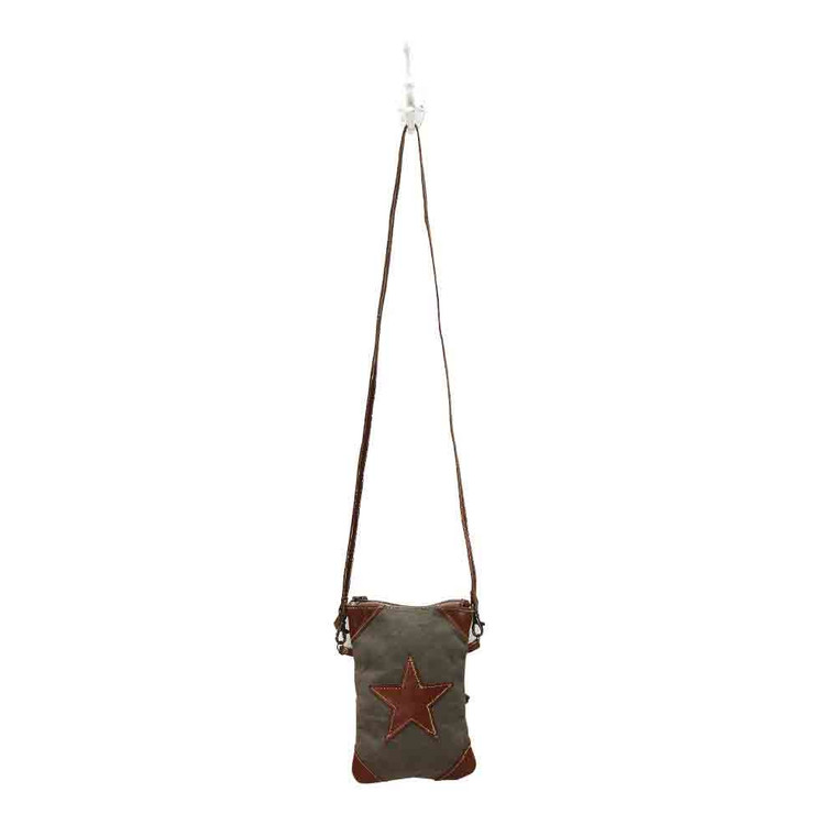 This upcycled canvas and leather crossbody is bound to become a favorite as because of its stylish look and perfect size.