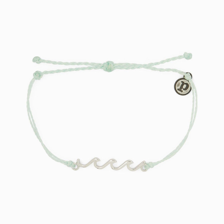 Wanna add another style to your Wave collection? Our new Delicate Wave Bracelet is the perfect piece to pick up if you're looking for a dainty design. Set on a simple string band with a low-profile silver wave charm.