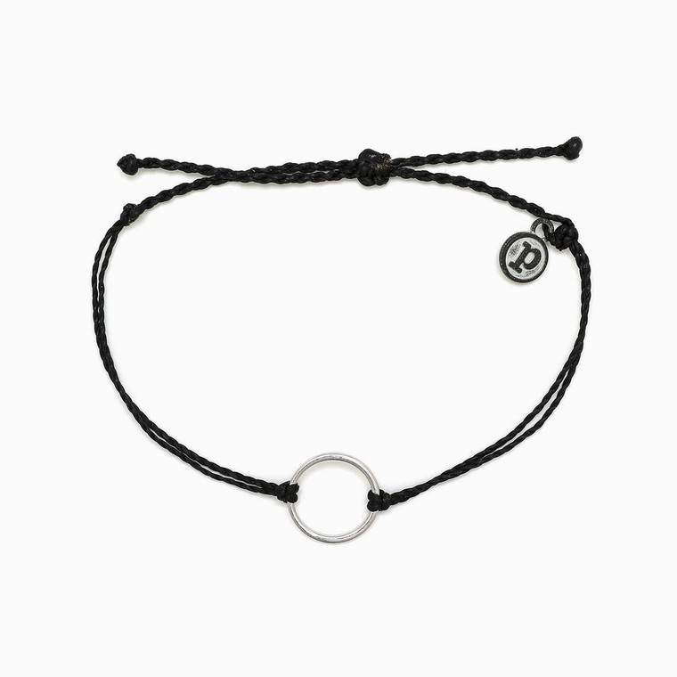 Our new Circle Charm Bracelet is the perfect style for stacking all year 'round (pun intended!). Available in two string colors, this bracelet features a circle-shaped charm in a gold or silver finish, and looks perfect when paired with an armful of Originals.