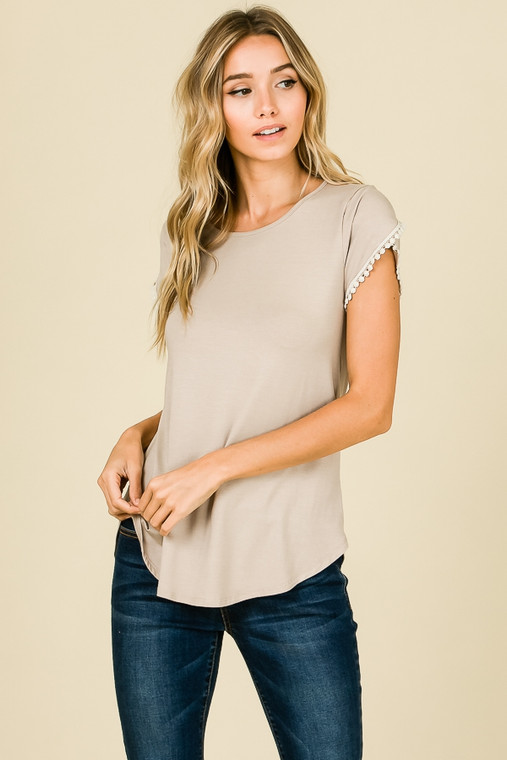 A twist on a classic. This short sleeved top takes a tee shirt to the next level, split short sleeved arms with lave detail dress this shirt up enough for a nice night on the town, yet casual enough for a day out and about shopping.