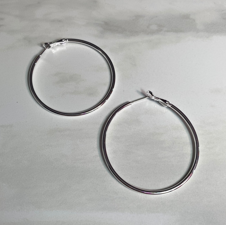 Simple. Basic. Classic. Your must-have silver hoop is the Betty.