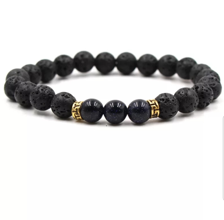 Lava stone accented with black beads. Easily apply your favorite essential oils directly to the porous lava stone bead and have your favorite scents on the go! Easy to wear, slide-on style elastic bracelet looks great by itself or stacked up with your other favorite bracelets.