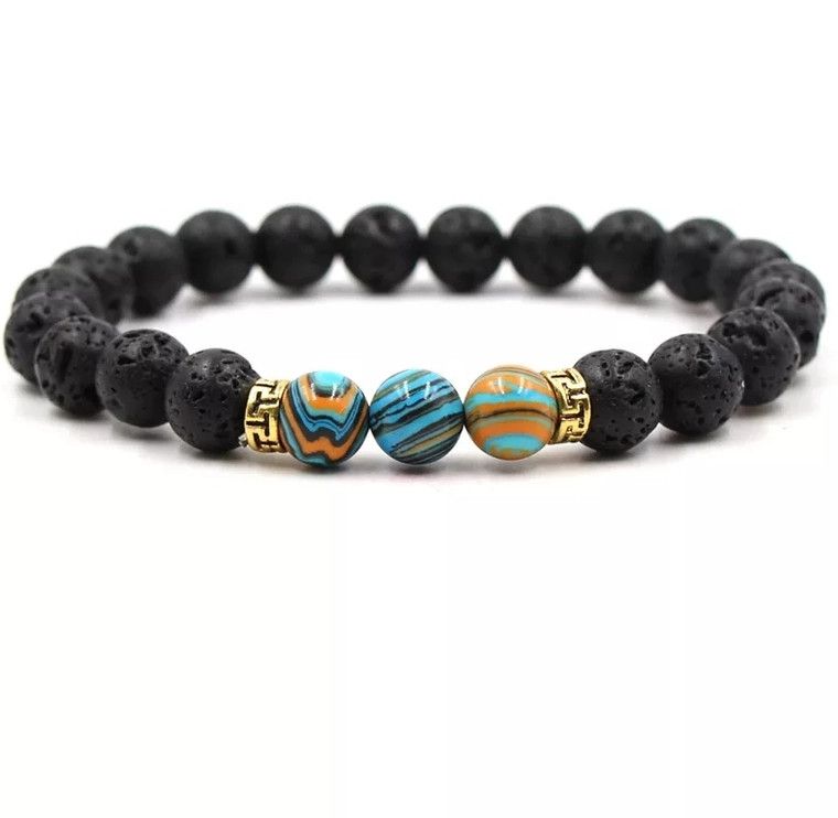 Lava stone accented with turquoise and salmon orange marbled beads. Easily apply your favorite essential oils directly to the porous lava stone bead and have your favorite scents on the go! Easy to wear, slide-on style elastic bracelet looks great by itself or stacked up with your other favorite bracelets.