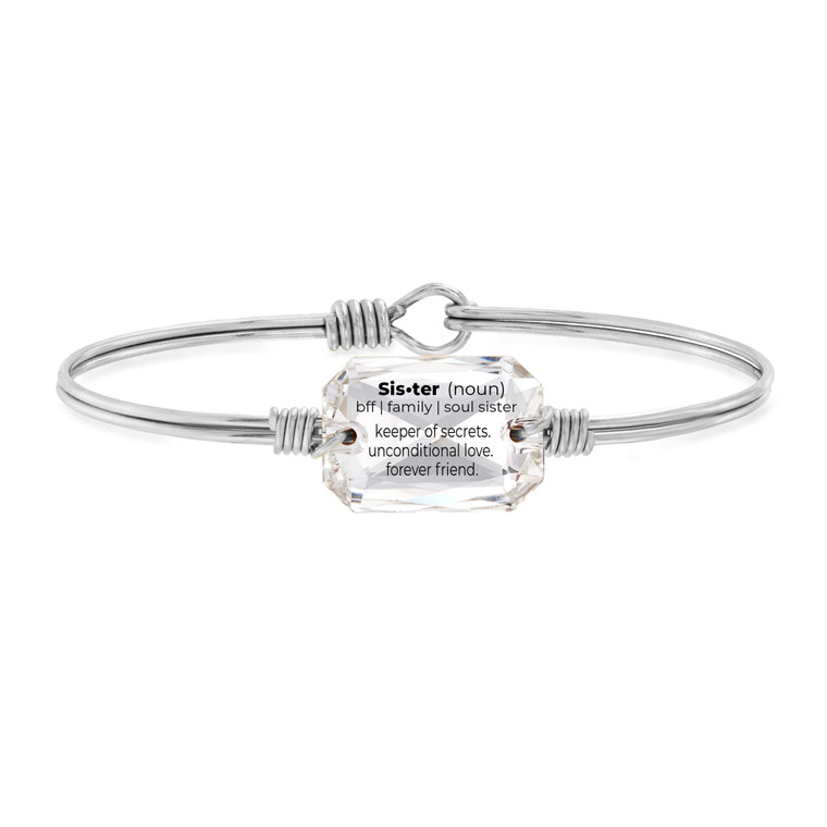 """Yeah, sister. This Swarovski® Crystal sister bracelet puts into words the unique bond that only siblings share. It's designed to reveal a secret message when held at just the right angle: A special definition of """"sister"""" that celebrates her unconditional love. Give one as a great sister's gift, or buy two for both of you to wear and share together.     Handmade using brass and artisan metals Easy hook and catch closure Regular or petite sizing options and oval shape ensures proper fit Silver tone finish Swarovski®emerald cut sew-on crystal laser engraved with sister definition Packaged in a gift box and includes an essence card Made in the USA"""