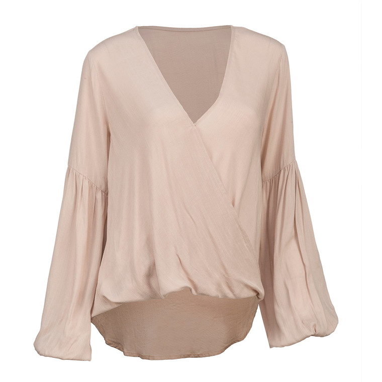 We call this top beach chic. Our Long Sleeve Top in the color sand is a dreamy blouse with balloon sleeves, lightweight fabric and an overall loose fit.