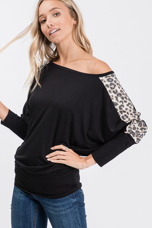 Rawwwwr! This Black Dohlman Top with Leopard Detail is just right... just right for a night out and just right for a casual night out. It can be worn regular style of styled as an off-the-shoulder top. It fits just right at the hips for a slimming look for all body types.