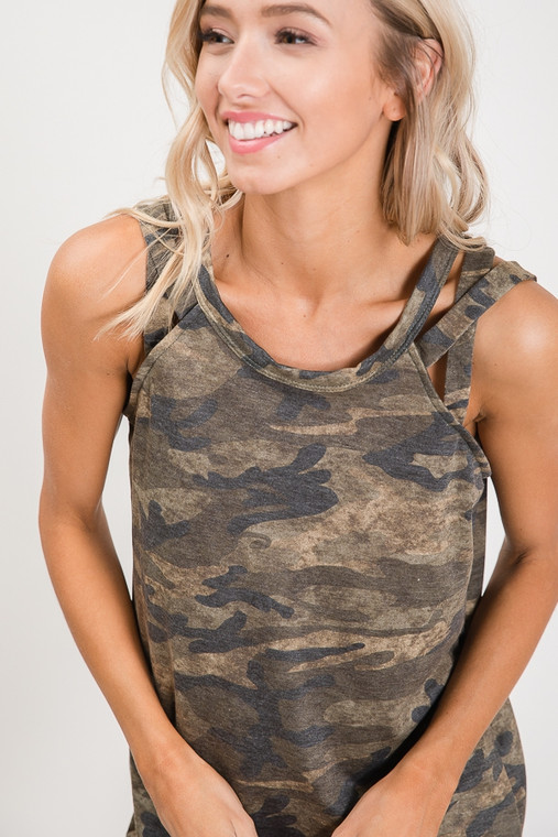Where are my camo lovers at? Be summer-ready with this super adorable three-strapped crissy-crossy strap tank. Long enough to wear with leggings or give the front a tuck for a cute look with jeans or shorts. Take it into cool nights under a cardigan or your favorite jean jacket.
