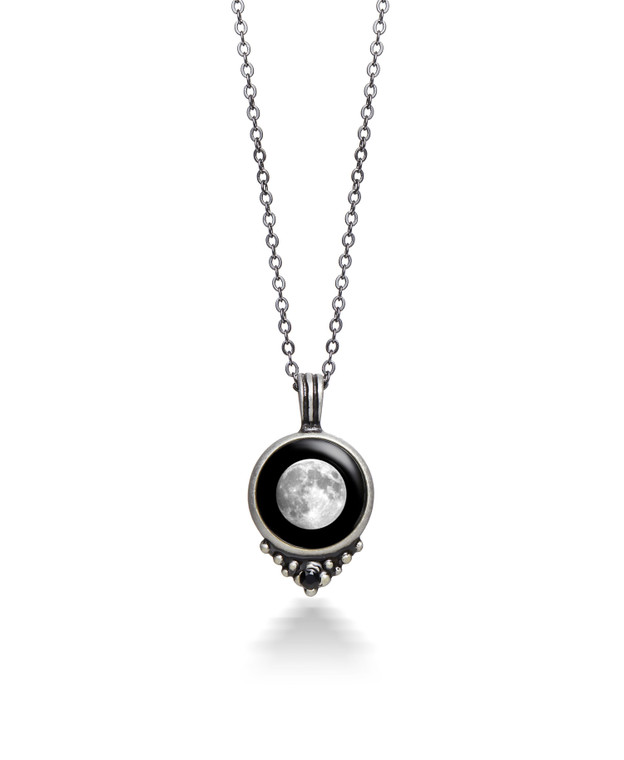 Our Moonglow necklace combines an awe-inspiring moon phase charm with the luxe sparkle of a black Swarovski crystal. Crafted with a vintage feel in hand-finished pewter and paired with a black pewter chain, each necklace is unique to the wearer. Simply select any special day, whether it's your birthday, the day you tied the knot, or landed that well-earned promotion––every meaningful milestone deserves to be celebrated!  Like the moon itself, our lunar charms catch the rays of the sun by day to illuminate in darkness––creating a soft soulful glow that will surely be a conversation starter.   ** The MOON PHASE CODE you will choose when you add to cart will be listed under the picture of the moon in the YOUR RESULTS area after you enter your date in the Moon Phase Calculator.