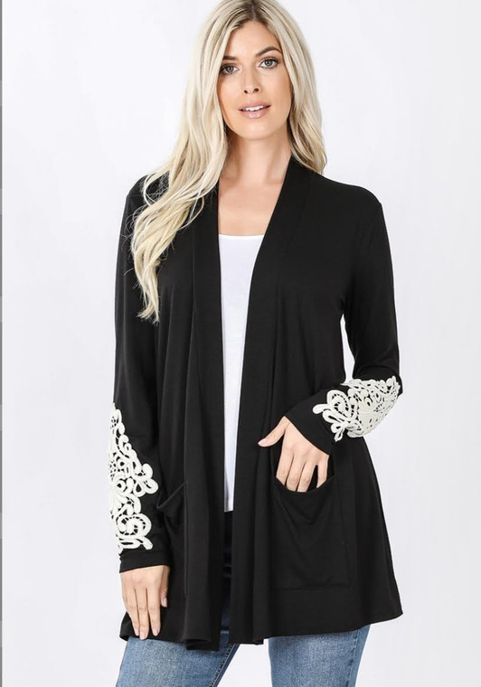A favorite staple with some amazing lace detail is back! This cardigan literally goes with everything. It looks great over sundresses, over tanks with leggings or even paired with cropped jeans or shorts on a cool summer night. Fits true to size or can even be sized down a size with its open front design.