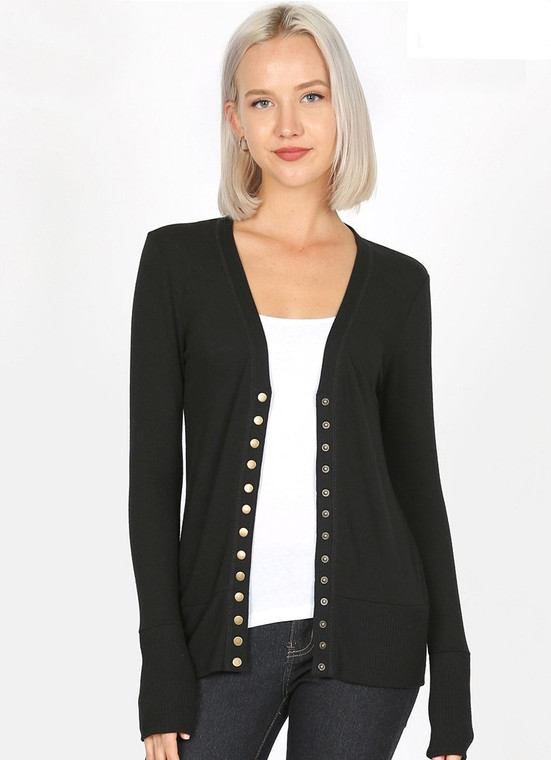 The must have piece that goes with everything in your wardrobe. This light weight snap front cardigan is the perfect weight fabric for all seasons. Looks great with jeans, dress pants, leggings or over a sundress. Fits true to size.     POLYESTER 62%, RAYON 34%, SPANDEX 4%