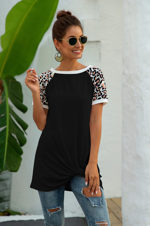 Sasssy and Splendid indeed! This extra long short sleeve tee is gathered at the side for an updated look to a classic. The sassy leopard print on the sleeves is just enough to show your animal print love!