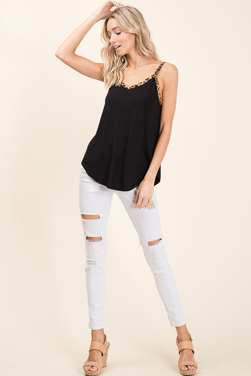 This adorable black tank has just enough leopard detail to make a statement. Pair it with just about anything! Looks fab with jeans or shorts, long enough for leggings.... you name it! Add it to your closet today!