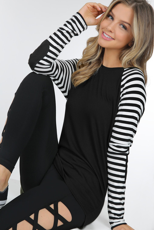A perfect piece for all seasons. Light weight enough with shorts on a warm summer's evening, yet perfect with jeans in colder weather. The stripes and the added detail of the elbow patch make this a cute, stylish addtion to your closet. Fits true to size.
