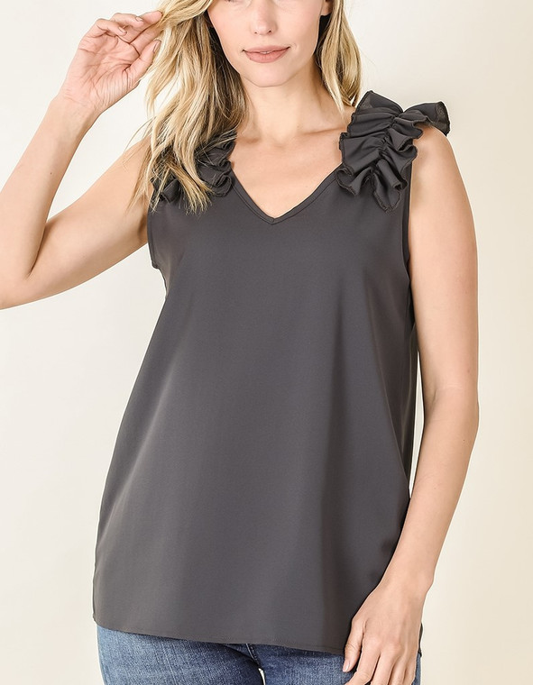 Need a tank that can go from day to night in a snap? Then look no further. This flowy material and ruffled shoulder design make it a perfect piece for work, yet can easily be paired with jeans or shorts for a casual look. Grab one in each color, you won't be dissappointed!  Fits true to size.  100% polyester